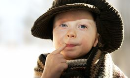 Frolicsome fellow. Thoughtful funny child, space for text Royalty Free Stock Images