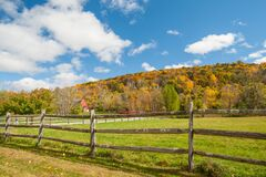 From American Country Road A Rural Landscape With Red Barn In Distance Beyond Rustic Post And Rail Fence In Kent County Royalty Free Stock Photography
