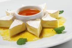 Fromage avec l'orange de miel Photo libre de droits