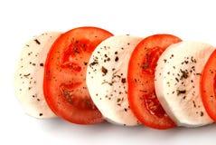 Fromage de mozzarella avec des tomates Image libre de droits