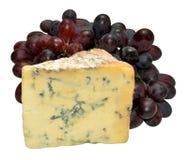 Fromage et raisins de stilton Photographie stock libre de droits