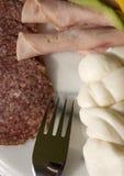 Fromage et salami Photos stock