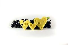 Fromage préféré et raisins noirs Image libre de droits