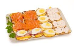 Fromage, saumon, oeuf, crevettes roses, casseur d'apéritif de jambon Photographie stock libre de droits