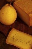 Fromage suisse et poire Photographie stock libre de droits
