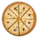 Fromaggi del quattro de la pizza en el tablero de madera Imagenes de archivo
