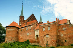 Frombork cathedral back view. Frombork, Poland - July 28 2013: walls behind frombork Cathedral, built in 1329-1388, gothic style. In this cathedral Nicolaus Stock Images