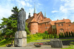 FROMBORK, POLAND. Monument to Nicolaus Copernicus and fragment of a cathedral complex. FROMBORK, POLAND - JULY 09, 2015: Monument to Nicolaus Copernicus and Stock Photo