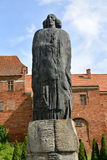 FROMBORK, POLAND. A monument to Nicolaus Coperniicus against the background of historical buildings. FROMBORK, POLAND - JULY 09, 2015: A monument to Nicolaus Royalty Free Stock Photography
