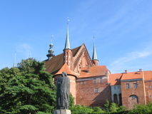 Frombork with statue of Copernicus. Town of Frombork in Poland. The place of work and death of Nicolae Copernicus - one of the greatest astronomers. In the stock images
