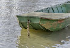 Front part of small fishing green boat. Docked on the river stock image