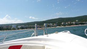 Fron view of a boat in the sea. Going fast. Active vacation stock video