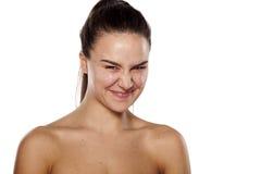 Froncement de sourcils et sourire Photos libres de droits