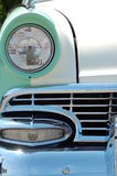 Front 1950's Ford. Front grill Ford headlight sea foam green stock photo