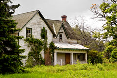 Front of Abandonded Lock Master's House. An abandoned, decaying Lock Master's House sits in the overgrowth at the Long Island Locks along the historic Rideau royalty free stock photography