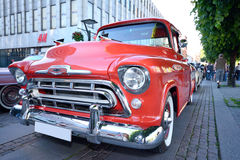 Front of an american retro car in red color Stock Photos
