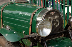 Front of antique car. Close up view of the front of a green antique automobile stock photos