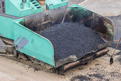 Front of a asphalt laying machine Stock Photography
