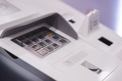 Front ATM panel with a keyboard for entering a password, a fingerprint scanner and a wireless connection. Royalty Free Stock Photo