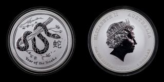 1 dollar Lunar 2 year of the snake 1oz 999 silver. Front and back of an Australian silver coin. 1 dollar Lunar 2 year of the snake 1oz 999 silver Royalty Free Stock Photo