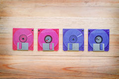 Front and back of floppy disk on wooden table Stock Photography
