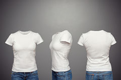 Blank feminine t-shirt. Front, back and side views of blank feminine t-shirt over dark background Stock Photos