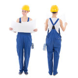 Front and back view of woman builder in blue coveralls holding b Stock Photo