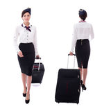 Front and back view of young stewardess walking with suitcase is Royalty Free Stock Photos
