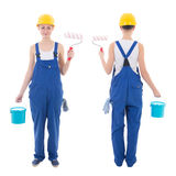 Front and back view of young woman painter in blue coveralls iso Stock Photo