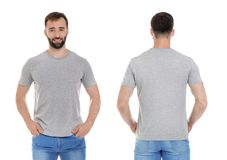 Front and back views of young man in grey t-shirt. On white background. Mockup for design stock photo