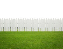 Front or back yard, white wooden fence on the grass isolated on