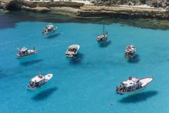 Fly on the water in the Lampedusa sea royalty free stock photography