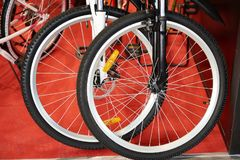 Front bicycle wheels in store Royalty Free Stock Photo