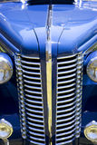 Front of blue antique car. Closeup of the hood and grill of a beautiful blue, antique car Stock Photos