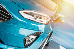 Front of a blue sport car in sunset Stock Image