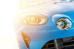 Front of a blue sport car in sunset light Royalty Free Stock Photography