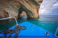 Tourist boat heading for Blue Caves in Zante. Front of a blue tourist boat heading for the Blue Caves, Zante Island, Greece stock photo