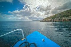 Tourist boat heading for Blue Caves in Zante. Front of a blue tourist boat heading for the Blue Caves, Zante Island, Greece stock images