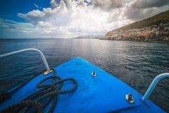Tourist boat heading for Blue Caves in Zante. Front of a blue tourist boat heading for the Blue Caves, Zante Island, Greece stock photos