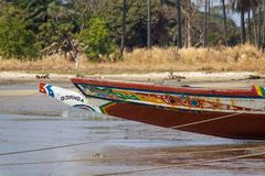 Front of a boat in Gambia. JUFUREH, GAMBIA- JAN 12, 2014: The front of the boat is colorfull and well painted. Boats are self made of what nature gives. Long royalty free stock photography
