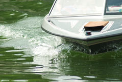 Front of a Boat/Waves. Close up of a ski boat coming into the dock, cutting through the water royalty free stock images