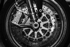The front brakes of a sports motorcycle Norton Commando 961 Cafe Racer. BERLIN, GERMANY - MAY 17, 2014: The front brakes of a sports motorcycle Norton Commando Royalty Free Stock Photos