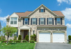 Front Brick Faced Single Family House Suburban MD. Single family house, with two car garage.  Maryland, USA Stock Images