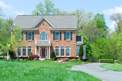 Front Brick Single Family House Home Suburban MD. Tidy Colonial Style single family house in suburban Maryland, United States.  House is brick faced and has a Stock Photography
