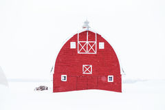 The front of bright red old barn Stock Photos