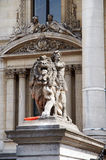 Front of the Brussels stock-exchange, architectural detail. Statue of a man and a lion, facade of the Brussels stock-exchange Stock Images