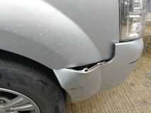 Front bumpers after a car accident. Front bumpers after a car accident in Metal background Royalty Free Stock Images