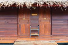 The front of the bungalow with a shoe rack. stock image