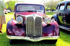 Front of burgundy classic car Stock Photo