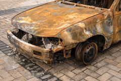 Front of burnt out abandoned car Royalty Free Stock Photo